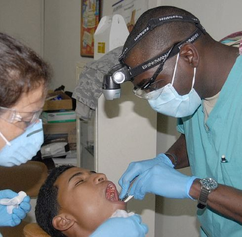 two dentists checking a patient's oral condition