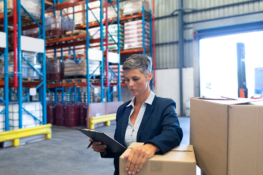 Woman doing an inspection in a 3PL warehouse