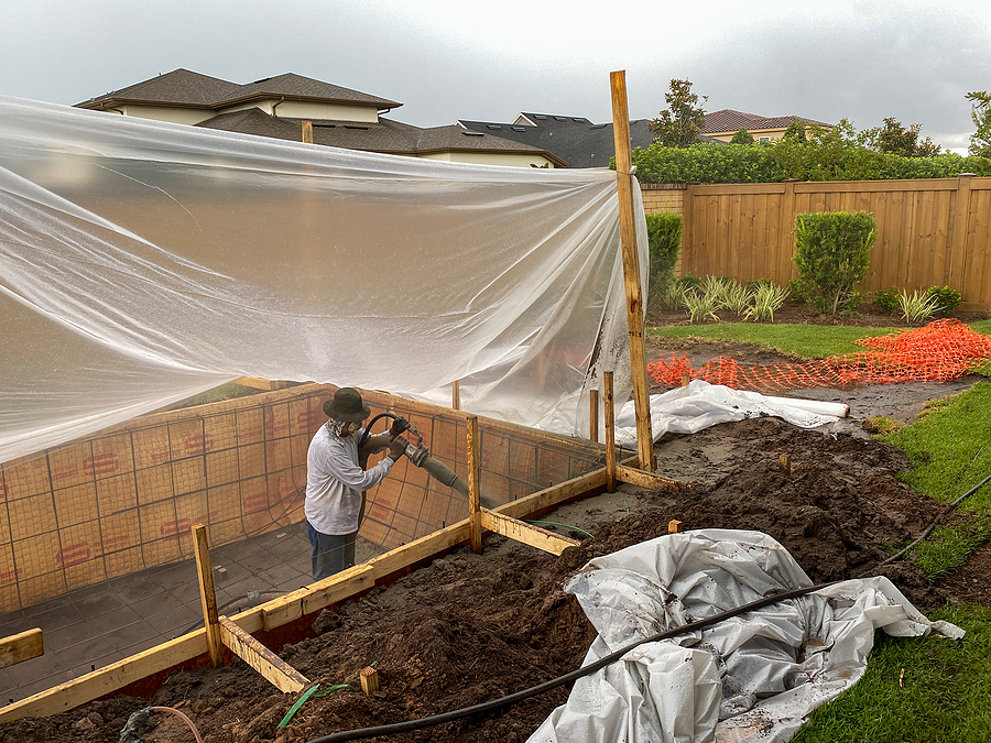 Best pool builders in Byron Bay digging a hole