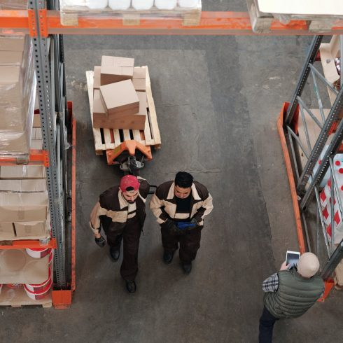 Workers inside a warehouse